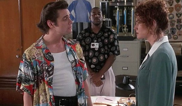 Jim Carrey, Tone Loc, and Sean Young in the problematic Ace Venture: Pet Detective
