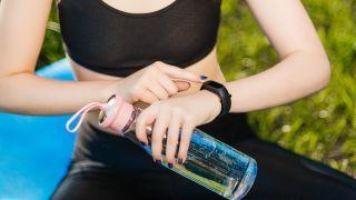 Woman wearing cheap fitness tracker