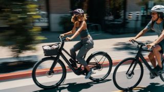 Two people riding e-bikes together