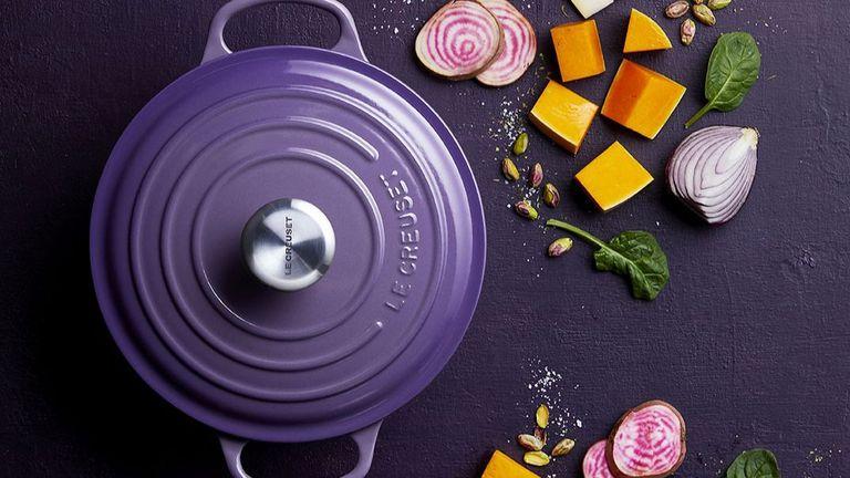 Le Creuset deals: cookware pot in purple surrounded by vegetables