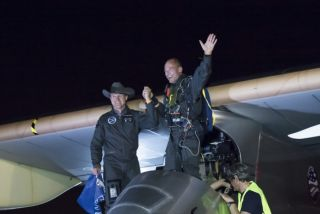 Solar Impulse founders Bertrand Piccard (in pilot seat) and André Borschberg in Phoenix at the end of the first leg of the solar plane's historic cross-country trip.