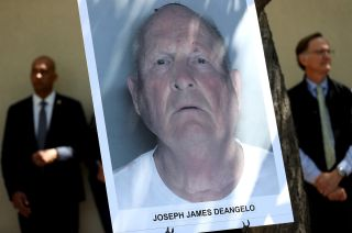 A photo of accused rapist and killer Joseph James DeAngelo is displayed during a news conference on April 25, 2018, in Sacramento, California.