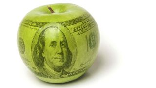 Green apple with superimposed $100 bill