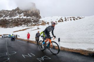 Bahrain Victorious' Damiano Caruso ascends Passo Giau on stage 16 and rides into second overall