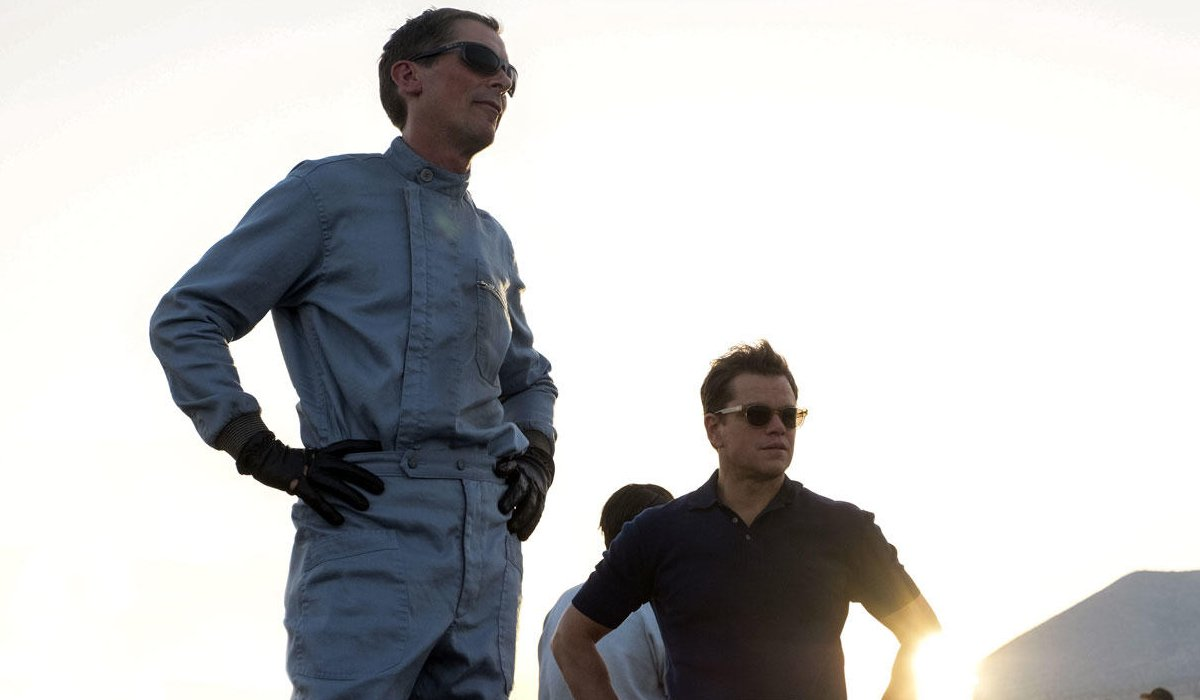 Ford v Ferrari Christian Bale and Matt Damon standing in the sunlight