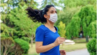 Woman running with mask