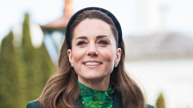 kate middleton wearing green and smiling