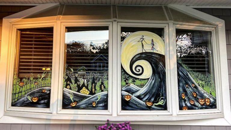 Halloween window ideas depicting Nightmare Before Christmas scene on bay windows