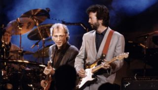 Mark Knopfler (left) performs with Eric Clapton