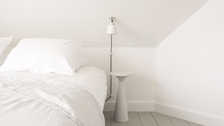 White bedroom with minimalist sheets and paint scheme