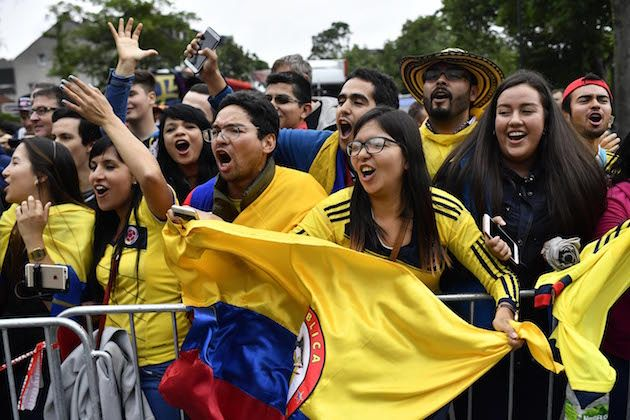 football shirts and flag waving the colombian fans who cheer their