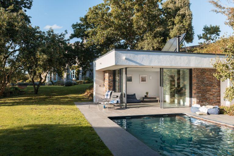 Pool house with sliding doors onto patio
