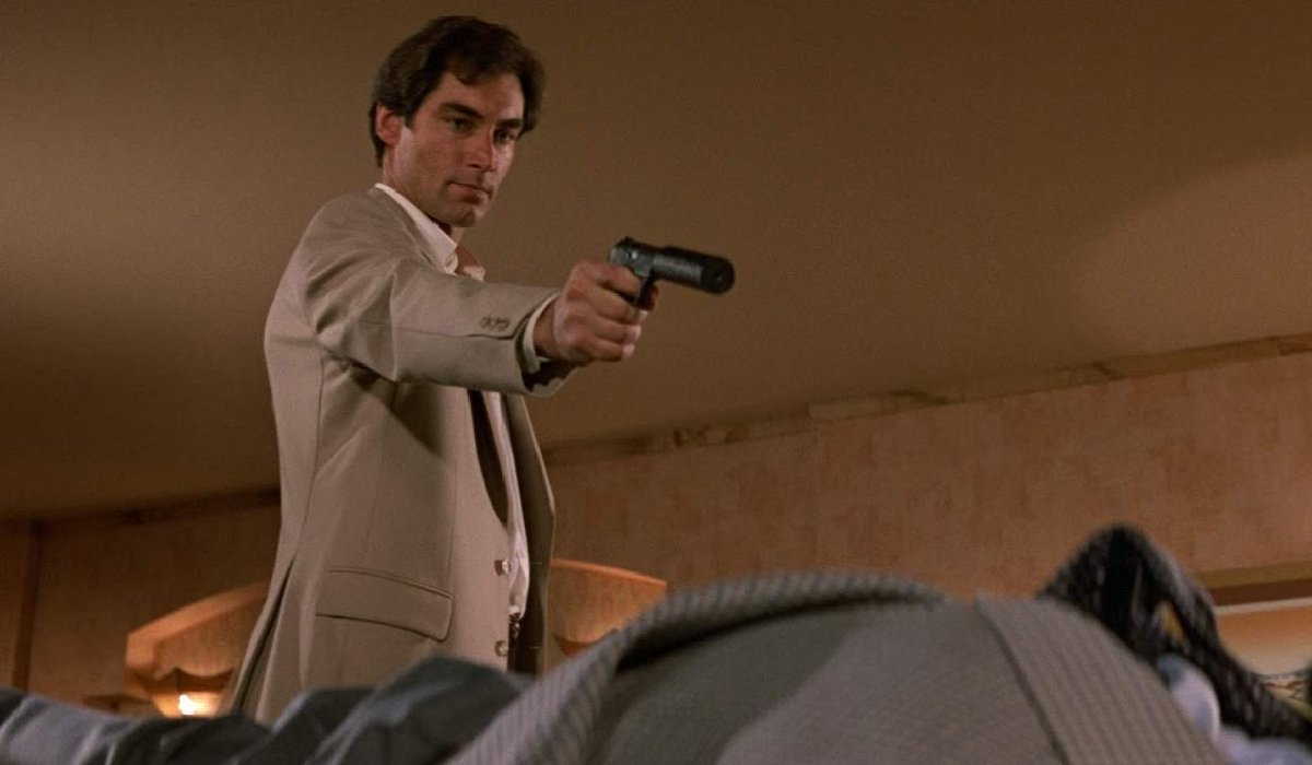 The Living Daylights Timothy Dalton aims his gun at a target on the floor