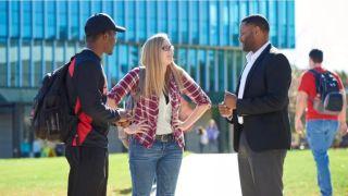 Maryville University President Mark Lombardi talks with students on campus