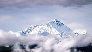 Mount Everest rises out of the clouds