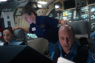 """Veteran NASA astronaut and """"For All Mankind"""" technical consultant Garrett Reisman takes a turn in front of the camera as a guest star in the second episode of Season 2 of the series. Reisman plays the commander of space shuttle Columbia in a scene alongside actors Jody Balfour (left), Sonya Walger and Bjørn Alexander."""