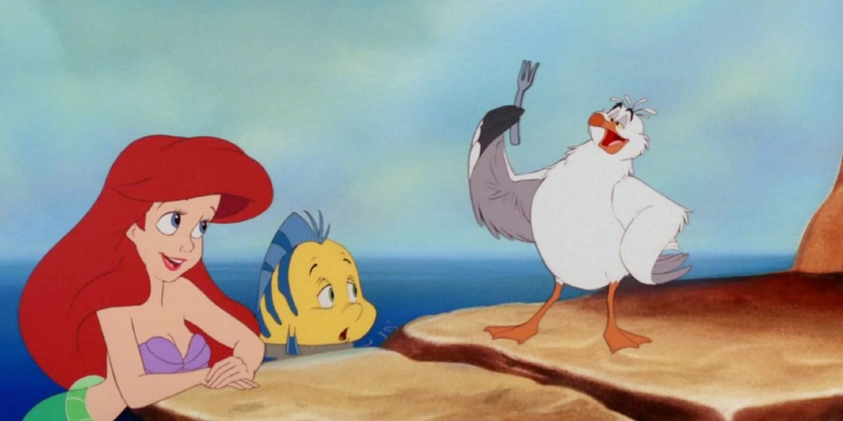 Ariel, Flounder, and Scuttle looking at a fork in The Little Mermaid