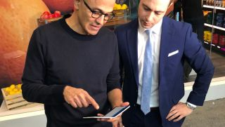 Microsoft CEO Satya Nadella showing off Surface Duo