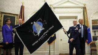 The official flag of the U.S. Space Force is unveiled at the White House event with President Donald Trump on May 15, 2020.