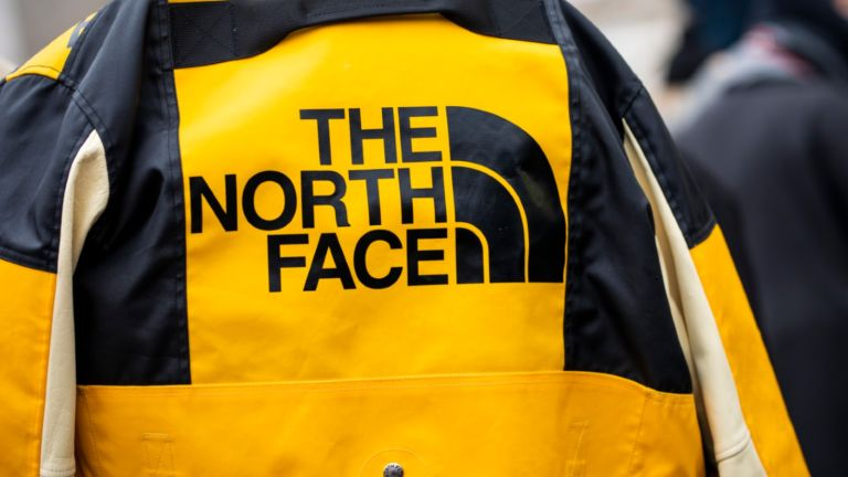 The North Face jacket details, is seen in the streets of Paris before the Acne Femme show on January 20, 2019 in Paris, France.