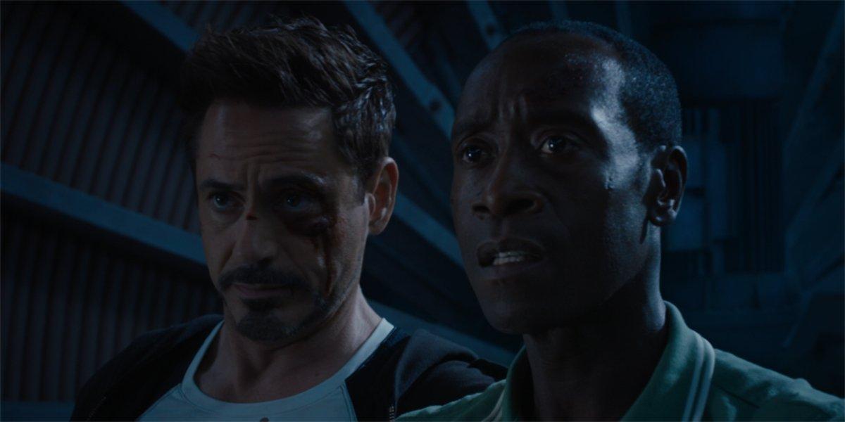 Tony Stark and Rhodey watch the Iron Legion in Iron Man 3