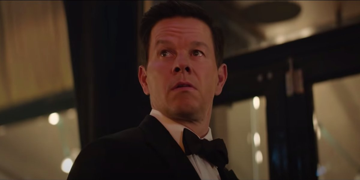 Mark Wahlberg standing outside in a tuxedo in Uncharted.