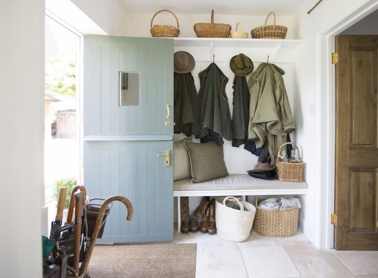 How to design a boot room: bootroom in hallway with coat hooks, bench abd umbrella stand by wickenden hutley