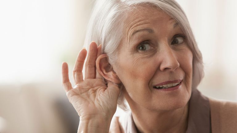 Woman struggling with hearing loss