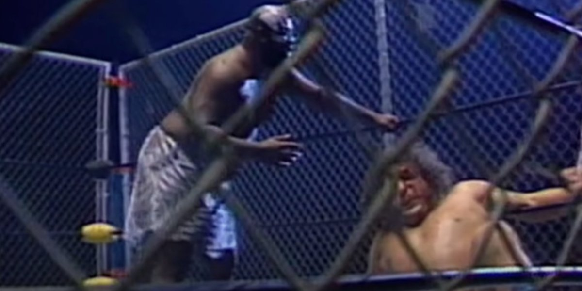 Kamala and Andre the Giant in a steel cage match