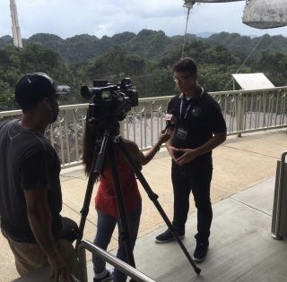 An image of Wilbert Ruperto-Hernández at the Arecibo Observatory.