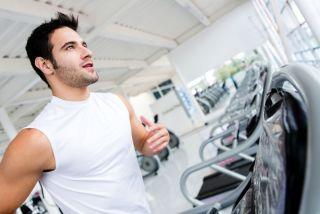 A man runs on a treadmill
