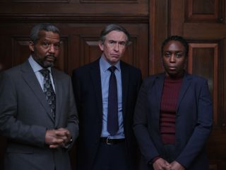 Stephen: Hugh Quarshie as Neville Lawrence, Steve Coogan as DCI Clive Driscoll and Sharlene Whyte as Doreen Lawrence, all in suits and standing in a dark panelled room