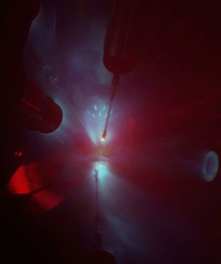 Laser-shock experiment to super-heat material that recreates conditions deep inside Earth.
