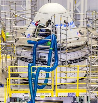 Boeing's second CST-100 Starliner spacecraft undergoes preparations for the Orbital Flight Test-2 (OFT-2) mission in the Commercial Crew and Cargo Processing Facility at NASA's Kennedy Space Center in Florida on April 28, 2021. The spacecraft is scheduled to launch July 30.