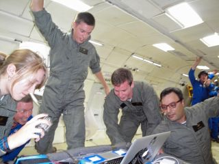 Student engineers with the UCSD Microgravity Team measure how biofuel-fed fires behave in weightlessness during a zero-gravity flight with NASA's Microgravity University and ZERO-G based out of Ellington Field, Houston on July 19, 2013.