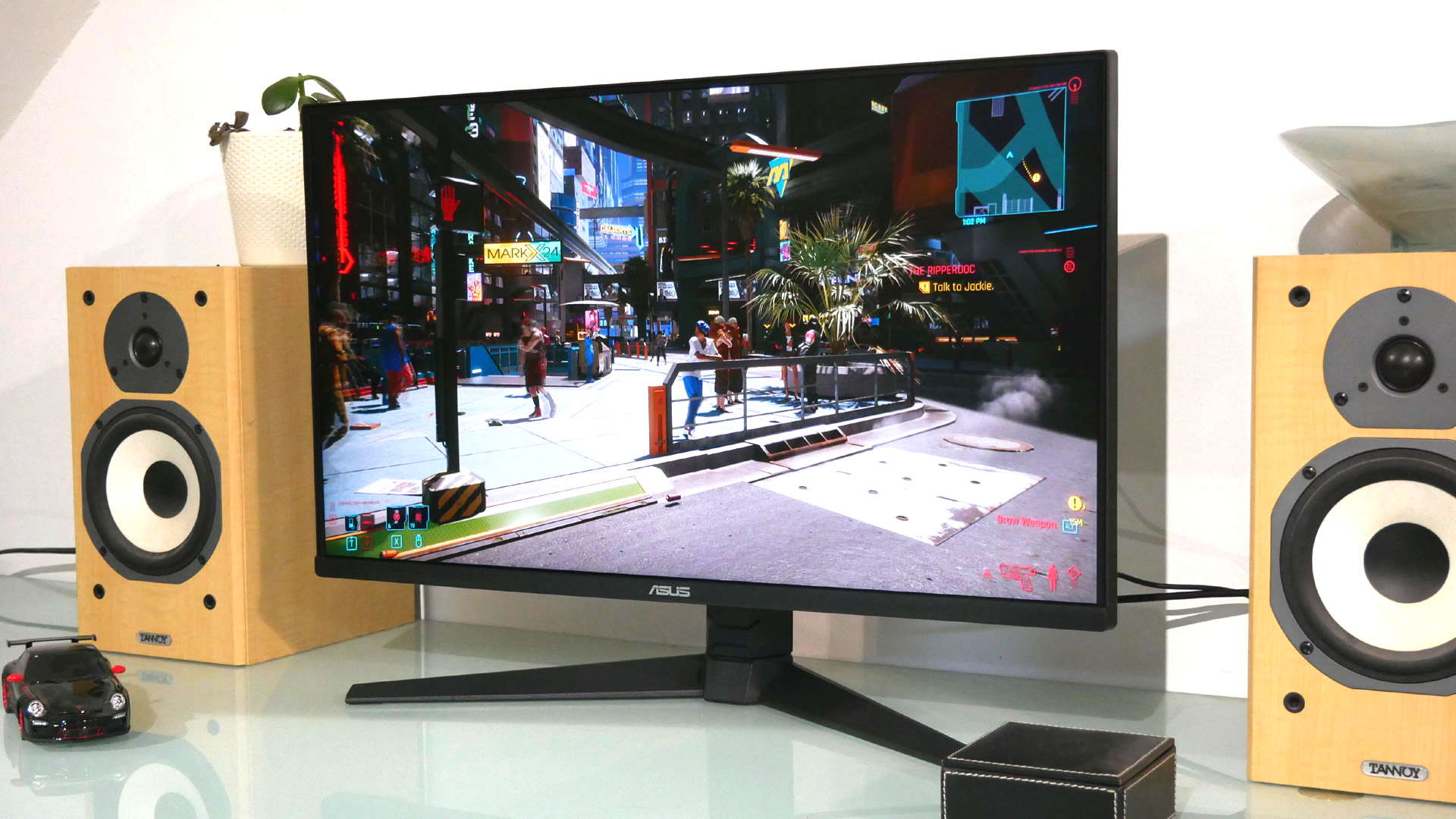 Asus TUF VG28UQL1A gaming monitor with Cyberpunk 2077 on the screen