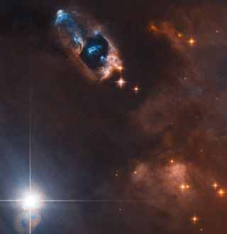 Five bright patches of gas created by a newborn star in nebula NGC 1333