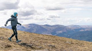 Sabrina Verjee descends from Low Man Skiddaw in a strong wind during her Wainwrights run - copyright Steve Ashworth-2 2.jpeg Sabrina Verjee descends from Low Man Skiddaw in a strong wind during her Wainwrights run