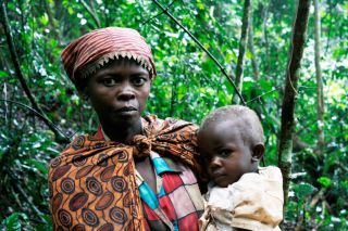 A Batwa woman and her child, pygmies who live in the rainforest, shown here in Bwindi Impenetrable Forest National Park, Uganda.