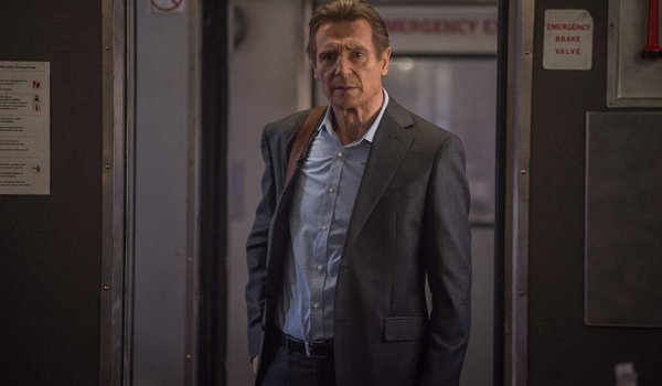 The Commuter Liam Neeson walking between trains with a puzzled look