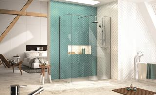 Walk in shower with glass screen and green tiles
