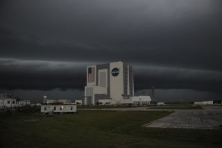 Storm clouds loom over the Vehicle Assembly Building at NASA's Kennedy Space Center in Florida.