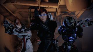 Shepard, Mordin, and Garrus posing like heroes