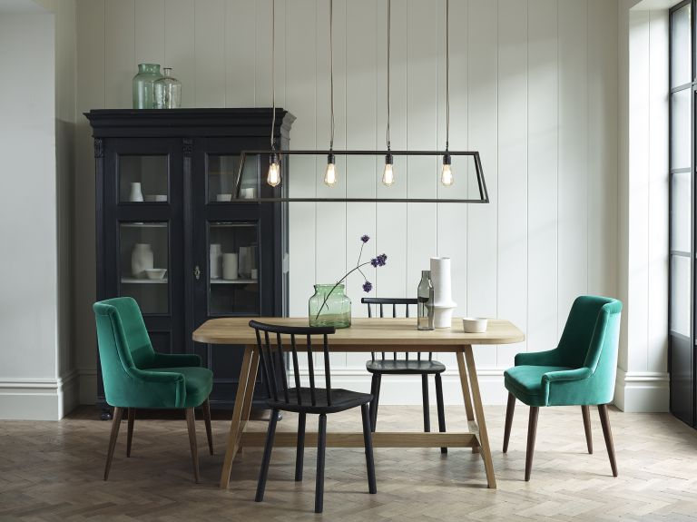 white dining room with green chairs and industrial black pendant light by Davey
