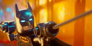 LEGO Batman snarls as he holds onto his weapons in 'The LEGO Batman Movie'
