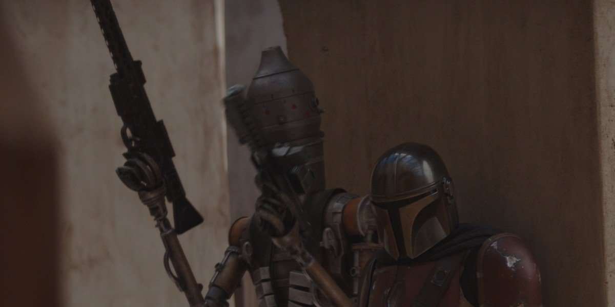 Mando and a droid getting ready for battle