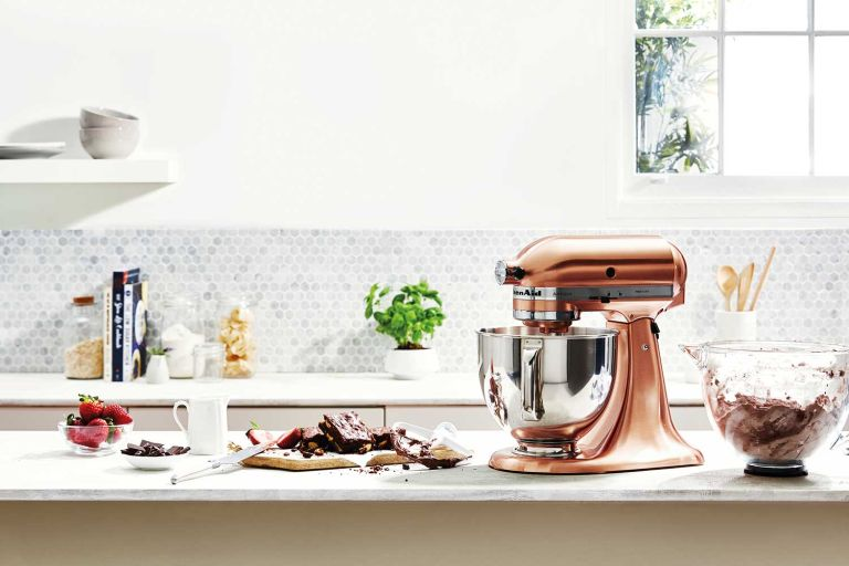 Copper Kitchenaid mixer in an all white kitchen