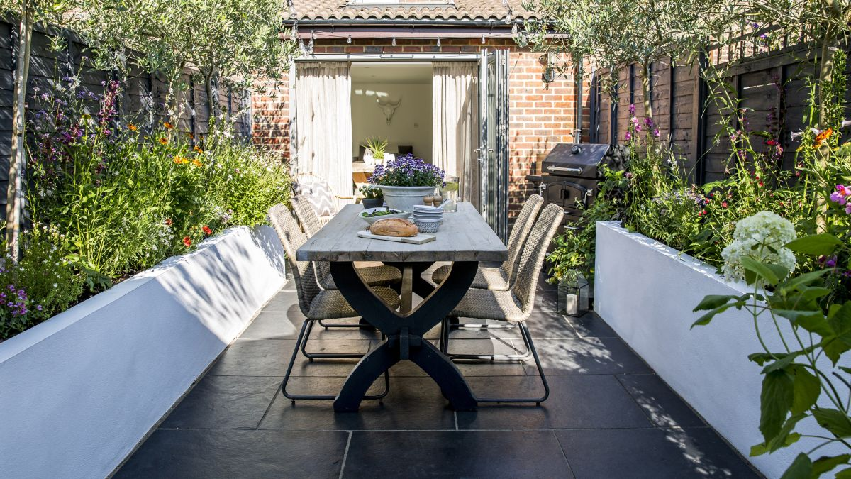 See how a small plot has been transformed into a stylish space for entertaining
