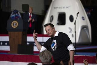 SpaceX founder and CEO Elon Musk celebrates the successful launch of the SpaceX Crew Dragon Demo-2 mission at NASA's Kennedy Space Center in Florida, on May 30, 2020.