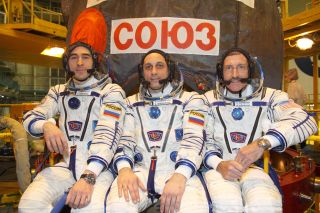 Russian cosmonauts Anatoly Ivanishin (left) and Anton Shkaplerov (center), and NASA astronaut Dan Burbank (right) are scheduled to the International Space Station on Nov. 13, 2011.